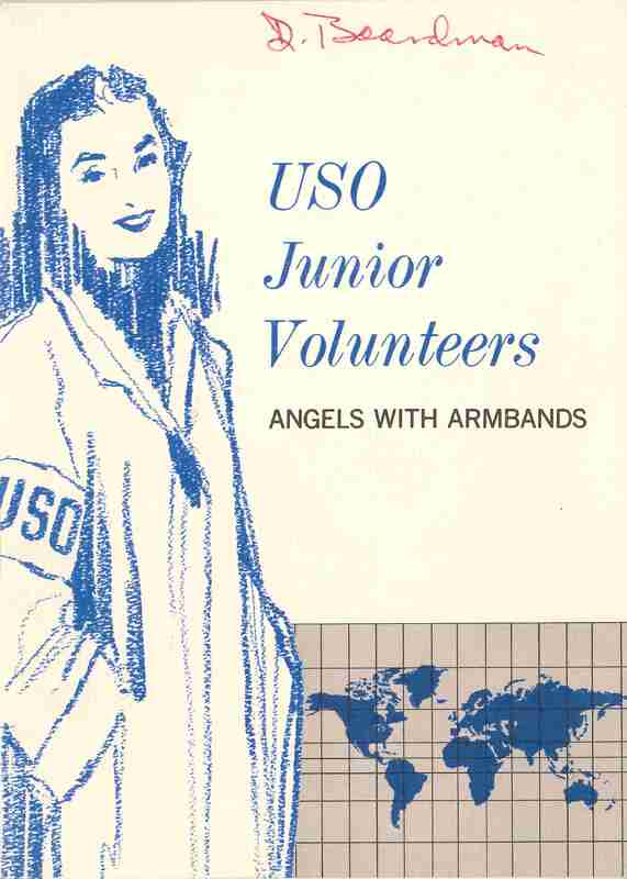 USO Junior Volunteers: Angels with Armbands; a smiling young woman stands in front of a world map wearing a USO arm band