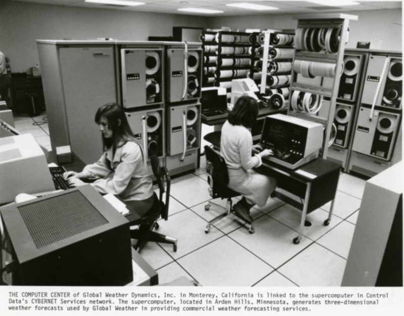 Global Weather Dynamics, Inc ; Women seated at terminals in computer center