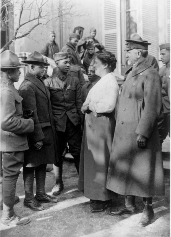 Addie Hunton, YMCA worker for American soldiers in World War I in France; Addie Hunton greeting African American troops in France during World War I