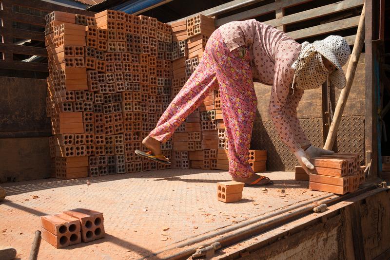 Girl Loading Bricks in Phnom Penh, Cambodia
