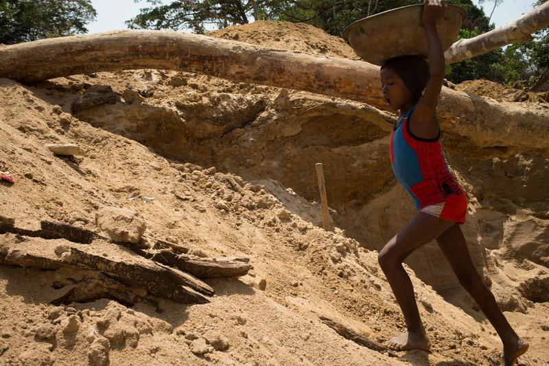 Girl in Superhero Shirt at Diamond Mine in Tikonko Chiefdom, Sierra Leone