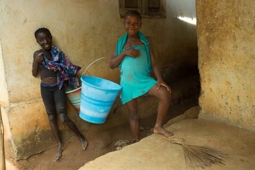 Girls Carrying Water Buckets, Tikonko Chiefdom, Sierra Leone