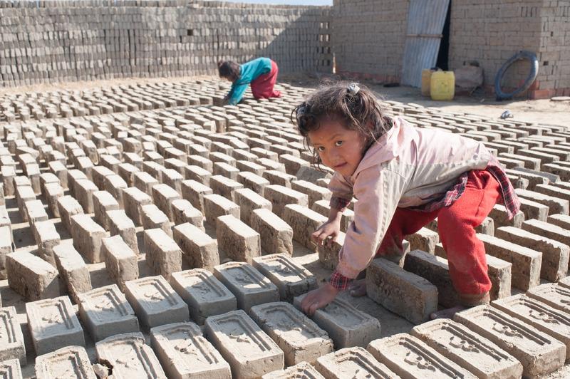 Little Girl Turning Drying Bricks, Nepal