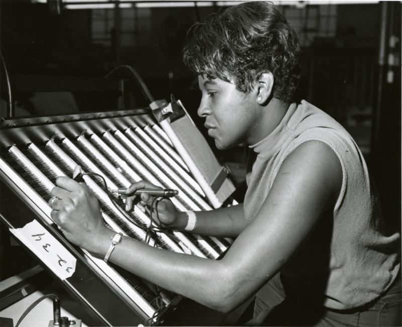 Northside Plant ; woman soldering