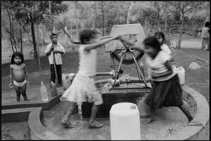 Children Playing at a Well in Nicaragua